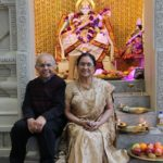 Kalyan and Rita Mustaphi pose in front of Goddess Saraswati